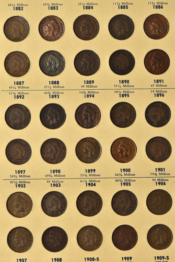 Collection of Flying Eagle and Indian Head cents in a Library of Coins album